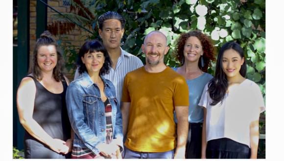 A group of smiling Unitec Contemporary Dance Staff posing for a photo